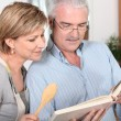 Royalty-Free Stock Photo: Mature couple looking at a recipe book