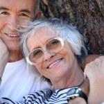 Elderly couple enjoying each other's company — Stock Photo