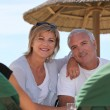 Couple in a beach bar — Stock Photo