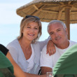 Couple in a beach bar — Stockfoto