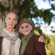 Elderly couple taking a walk together in the forest — Stock Photo