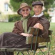 Older couple sitting on a bench — Stock Photo