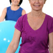 Two middle-aged women with gym balls — Stock Photo #7791499