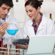 Oenologists working in a lab — Stock Photo #7791659