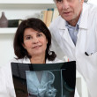 Stock Photo: Two doctors examining x-ray image