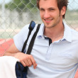 Stock Photo: Tennis player with bag