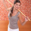 Young woman doing fitness with a stick — Stock Photo #7792084
