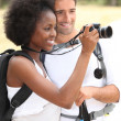Couple taking pictures — Stock Photo