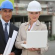 Businessman and female assistant on a construction site — Stock Photo