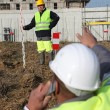 Two men measuring construction site — Stock Photo