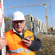 Surveyor on a construction site — Foto de Stock