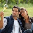 Young couple tasting their wine production - Stock Photo