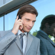 Stock Photo: Slick executive using cellphone