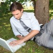 Businessman working outside on laptop — Stock Photo