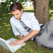 Stock Photo: Businessmworking outside on laptop