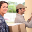 Woman receiving a package — Stock Photo