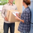 Woman receiving shipment at home — Stock Photo