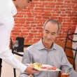 Waitor serving food — Stock Photo