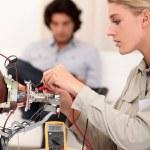 Woman repairing television — Stock Photo