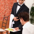 Smart waiter in restaurant — Stock Photo