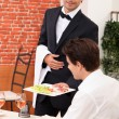 Waiter deliver in meal in restaurant — Stock Photo