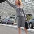 Businesswomwaving taxi — Stock Photo #7795000