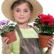 Little girl holding flower pots — Stock Photo
