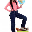 Young female builder holding globe — Stock Photo