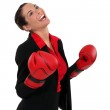 Ecstatic businesswoman with boxing gloves — Stock Photo #7796343