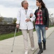 Young woman assisting a senior lady — Stock Photo #7796798