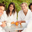 Friends having breakfast together — Stock Photo