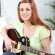 Stock Photo: Teenager playing guitar