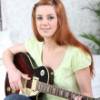 Teenager playing the guitar - Stok fotoğraf