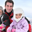 Family in snowsuits — Stock Photo