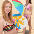 Stock Photo: Portrait of two girls playing rackets on the beach