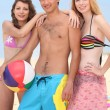 Stock Photo: Teenagers on a beach