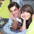 Stock Photo: Young couple lying in tent