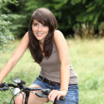 Brunette teenager alone on bike ride — Stock Photo