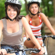 Portrait of 2 girls on bikes — Stock Photo #7798425