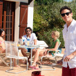 Friends having a barbecue on a sunny day — Stock Photo