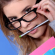 Girl with a pencil in her mouth — Stock Photo
