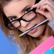 Stock Photo: Girl with pencil in her mouth