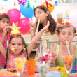 Foto Stock: Children at birthday party