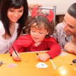 Little boy in Halloween costume with his parents — Stock Photo