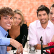 Stock Photo: Family sat in restaurant