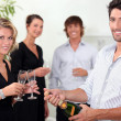 Popping the champagne — Stock Photo
