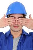 Tradesman covering his eyes — Stock Photo