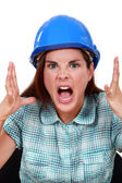 Furious craftswoman screaming — Stock Photo