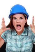 Furious craftswoman screaming — Stock Photo