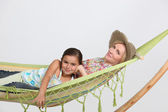 Mother and daughter in hammock — Stock Photo